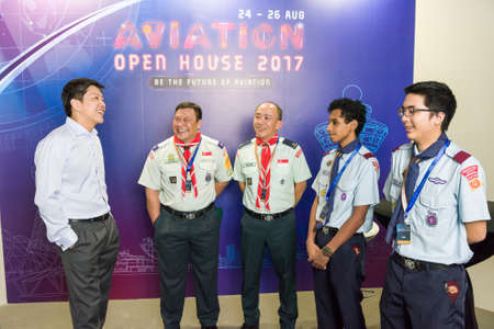 Singapore, 24 August 2017: Minister Ng Chee Meng speaking with representatives from Singapore Scout Association at the Aviation Open House.