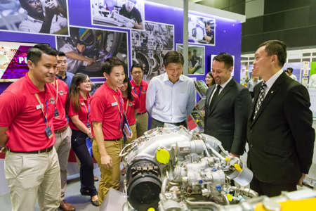Singapore, 24 August 2017: Minister Ng Chee Meng speaking with representatives from Pratt & Whitney at the Aviation Open House. Editorial