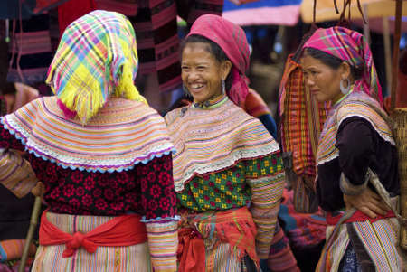 ha: BAC HA MARKET, VIETNAM - JULY 5: hilltribe women talk to each other on July 5, 2009. Bac Ha is hilltribe market where hilltribe people come to trade for goods Editorial