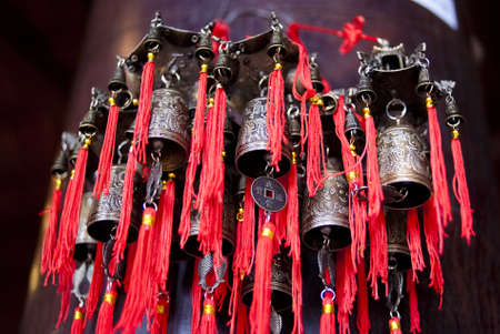 shop for animals: HANOI, VIETNAM - JULY 9: Bells for sale at a souvenir shop on July 9, 2009 in Hanoi, Vietnam. Animals sacred in Vietnams culture are normally engraved in the bells.