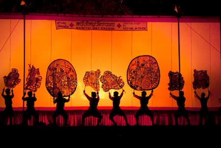 accompaniment: RATCHBURI, THAILAND - APRIL 13  Large Shadow Play is performed at Wat Khanon on April 13, 2010  The ancient performing art involves manipulating puppets of cowhide in front of a backlit screen with musical and narrative accompaniment Editorial