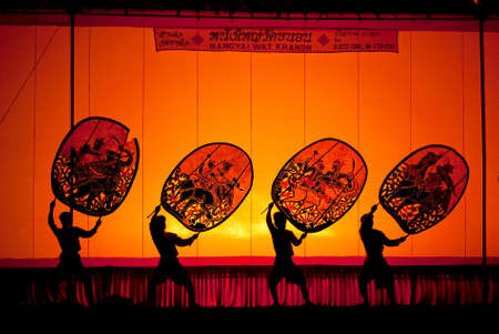ratchaburi: RATCHBURI, THAILAND - APRIL 13  Large Shadow Play is performed at Wat Khanon on April 13, 2010  The ancient performing art involves manipulating puppets of cowhide in front of a backlit screen with musical and narrative accompaniment Editorial