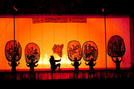 RATCHBURI, THAILAND - APRIL 13  Large Shadow Play is performed at Wat Khanon on April 13, 2010  The ancient performing art involves manipulating puppets of cowhide in front of a backlit screen with musical and narrative accompaniment