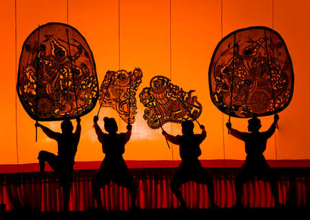 puppet theatre: RATCHBURI, THAILAND - APRIL 13: Large Shadow Play is performed at Wat Khanon on April 13, 2010. The ancient performing art involves manipulating puppets of cowhide in front of a backlit screen with musical and narrative accompaniment