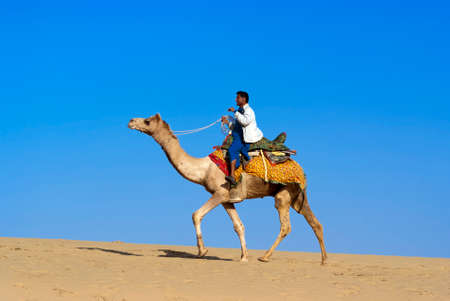 thar: JAISALMER, INDIA - FEB 25   Cameleer at the Sam Sand Dune on Feb 25, 2013 in Jaisalmer, India   Apart from farming, camel riding activity for tourists is another income source for desert villagers Editorial