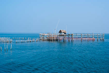 commercial fisheries: Trap netstake trap at the mouth of the Mae Klong river to the Gulf of Thailand in Samutsongkram Stock Photo