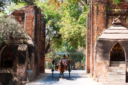 spiritual beings: BAGAN, MYANMAR - FEBRUARY 15  A carriage at the Tharabar Gate on February 15, 2011 in Bagan, Myanmar  Tharabar Gate is the main gate of the east wall and  is known to be guarded by spiritual beings   Editorial