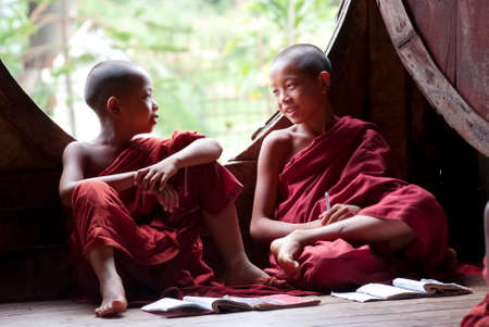 NYAUNG SHWE, MYANMAR – MAY 6  Novices at Shwe Yan Phe Monastery on May 6, 2012 in Nyaung Shwe, Myanmar  It is compulsory that boys between 8-20 years old have to enter the Buddhist Order for a week or more as a novice