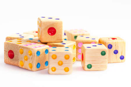 A pile of dice made of wood isolated on a white background
