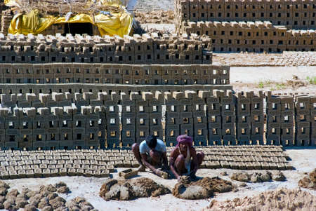 brick kiln: UTTAR PRADESH, INDIA- MAR 2  labourers prepare bricks at a brick kiln on March 2, 2013, in Uttar Pradesh, India  The Indian brick industry is the second largest in the world after China
