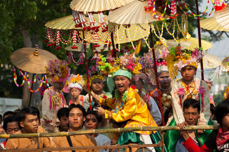 poi: MAE HONG SORN, THAILAND - APR 6:  Unidentified boys dressed in ornate costumes and heavy make-up in a Buddhist novice ordination ceremony on Apr 6, 2008 in Mae Hong Sorn, Thailand. The festival, associated with the Tai Yai or Shan people is known for its  Editorial
