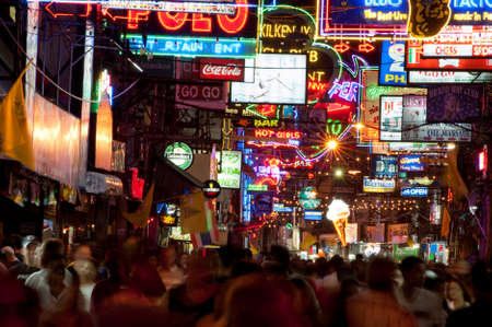 parlours: PATTAYA, THAILAND - JUN 30: Neon-drenched street on Jun 30, 2007 in Pattaya, Thailand. Bars, massage parlours and discos along the Walking Street are geared towards foreign tourists. Editorial