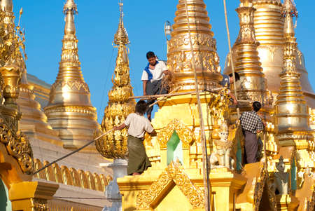 YANGON, MYANMAR - FEBRUARY 13: The  Shwedagon Pagoda being renovated on February 13, 2011 in Yangon, Myanmar. There is the need to carry out all-round renovation tasks for durability of the Shwedagon
