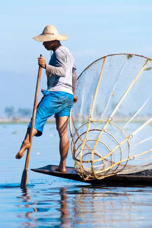 inle: INLE LAKE, MYANMAR - FEBRUARY 17: Fisherman catches fish for food on February 17, 2011 on Inle Lake, Myanmar. Intha people possess the leg-rowing style and the unique coop-like fishing equipment