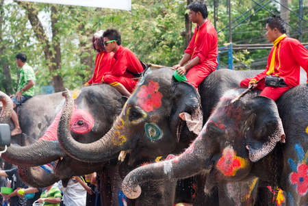 initiated: AYUTTHAYA, THAILAND - APR 14:  Elephants join in the Songkran Festival on Apr 14, 2014 in Ayutthaya, Thailand.  Initiated by Tourism Authority of Thailand, elephants also take part in the festival to give revelers more fun.