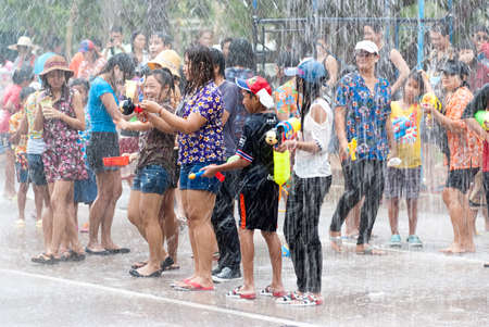 cool off: AYUTTHAYA, THAILAND - APR 13:  Revelers join in water splashing during Songkran Festival on Apr 13, 2014 in Ayutthaya, Thailand.  The water festival has long been observed as New Year and the occasion for people to cool off.
