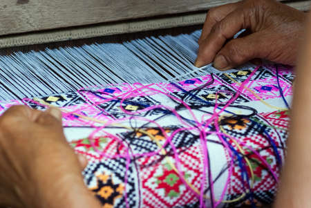 locals: Traditional hand weaving by locals in Nan Province, Thailand