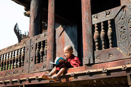 nat: BAGAN, MYANMAR MAR 2: a young novice stydying at Nat Taung Kyaung Monastery on Mar 2, 2015 in Bagan, Myanmar. Boys at 8-20 years old have to enter the Buddhist Order as a novice.