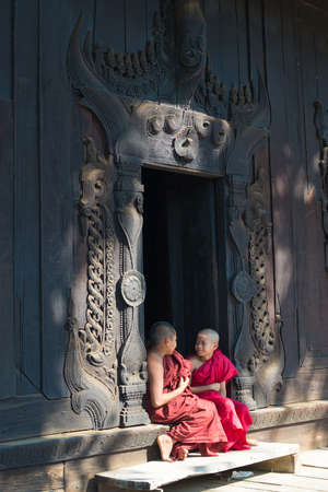 age 5: MANDALAY, MYANMAR – MAR 5: young novices rest leisurely at Bagaya Kyaung Monastery on Mar 5, 2015 in Mandalay, Myanmar. Young novices start their monastic life at the age of nine or ten.