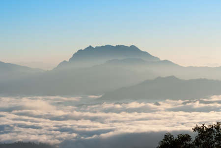 shrouded: Panoramic scenery of the mist shrouded mountains at sunrise