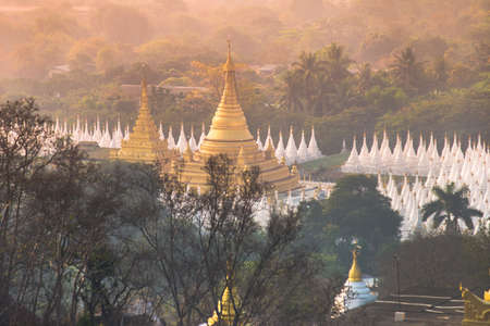 A pagoda viewed from Mandalay Hill at sunrise in Myanmar