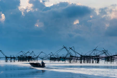 backwater: Fishing nets dotted along the Songkla lake. This is the traditional fishing method in the south of Thailand Stock Photo