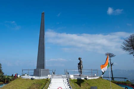 DARJEELING, INDIA – NOVEMBER 27, 2016: War memorial at the center of the Batasia Loop garden with Mt. Kanchenjunga in the background. This is a memorial for the Gorkha soldiers who sacrificed their lives in the wars after Indias independence. Editorial