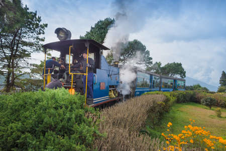 DARJEELING, INDIA – NOVEMBER 27, 2016: steam engine hauled DHR Toy Train has been operating on 2-foot gauge tracks since 1880s and gained the UNESCO World Heritage status. Editorial