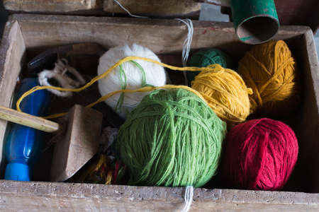 conservative: Box containing colored yarn balls for carpet weaving