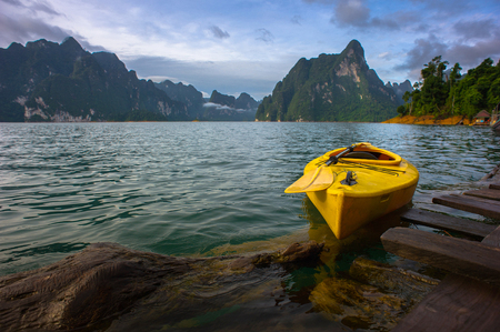 house float on water: Yellow boat with the raft house on the lake scene Stock Photo