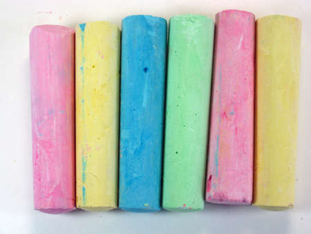 several sticks of brightly colored thick pavement chalk  Banco de Imagens