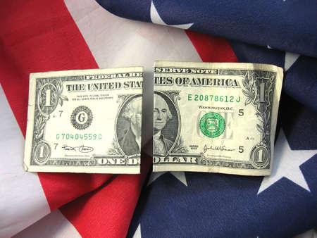 現金の finiancial 利益と愛国心をリンクとアメリカの国旗 写真素材
