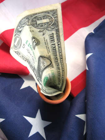 american flag with cash linking patriotism with finiancial interests Stock Photo