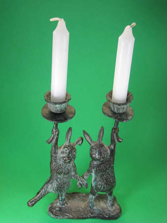 metal bunny candlestick holders and white candles Zdjęcie Seryjne