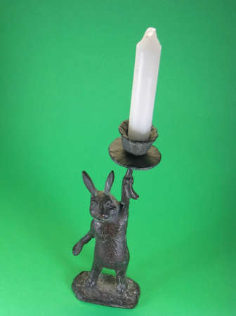 metal bunny candlestick holders and white candles Stock Photo