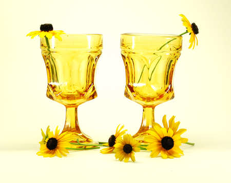 black-eyed susans flowers and drinking glasses still life