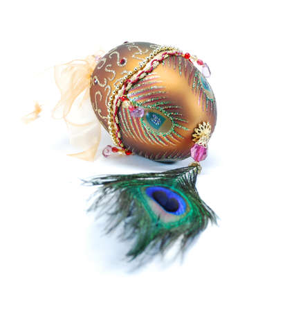 Decorated egg with  peacock feather beads and a bow