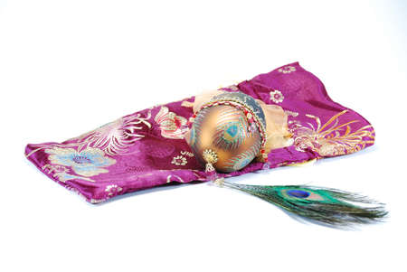 Decorated egg peacock feather and bag still life