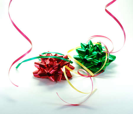 Festive ribbons and bows as used in wrapping gifts for holiday or birthday Stock Photo - 1449460