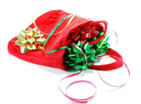 Festive ribbons and bows as used in wrapping gifts for holiday or birthday and red bag
