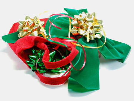Festive ribbons  bows as used in wrapping gifts for holiday or birthday with red bag