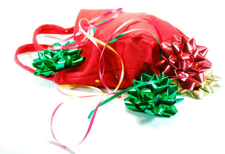 A bag and festive ribbons and bows as used in wrapping gifts for holiday or birthday