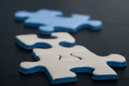 Jigsaw puzzle pieces on dark background