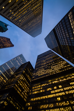 night view of Toronto city skyscrapers; look up; urban skyline; business center of big city Stock Photo