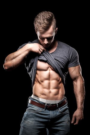 bodybuilding sportsman showing perfect abdominal abs muscles; perfect torso of attractive gym man Imagens