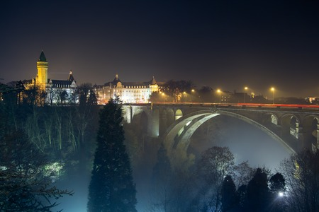 adolf: night skyline of luxembourg adolphe bridge; beautiful scape of old historical european country