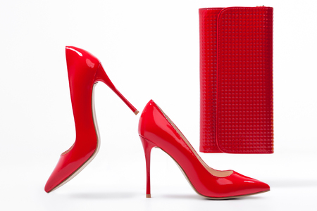 clutch bag: isolated red stylish stiletto shoes with clutch bag; studio shot of classic woman footwear and accessories; Stock Photo