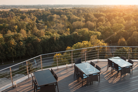 table top: beautiful sunset view from rooftop restaurant; skyline of park from roof top bar or cafe; Stock Photo