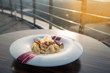 parmezan: italian carbonara pasta with meat and cheese; traditional meal of italy with parmesan;