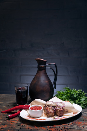 georgian food with greens on wooden background